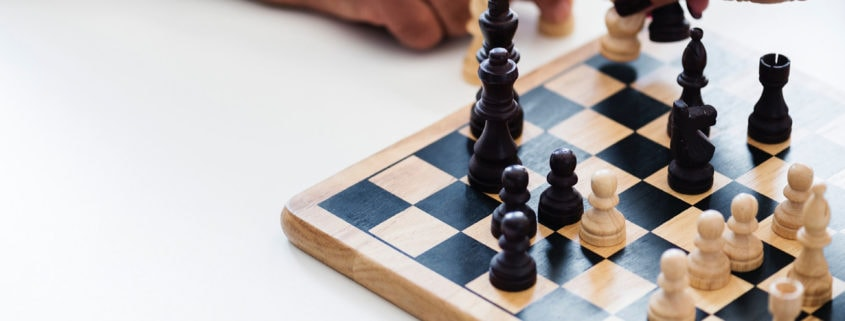 Playing chess on a white table