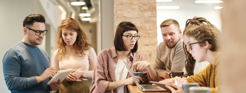 Group of young professionals with electronic devices