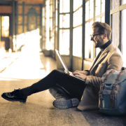 Man sitting on the ground with his laptop